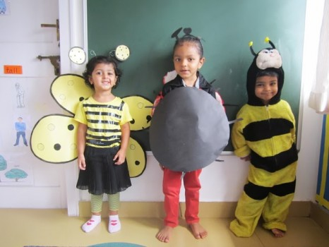 """Kids from Ahmedabad learning the alphabet """"i"""" for insects"""